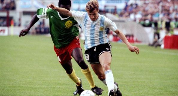 8 Jun 1990:  Claudio Caniggia of Argentina is shadowed by Benjamin Massing of Cameroon during the...