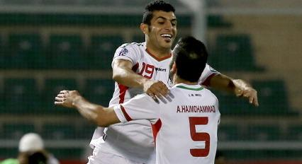 MUSCAT, OMAN - JANUARY 12:  Behnam Barzay (L) celebrates with team-mate Mohammad Amin (R) after s...
