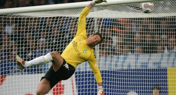 GELSENKIRCHEN, GERMANY - OCTOBER 27: Tim Weise of Bremen saves a ball during the Bundesliga match...