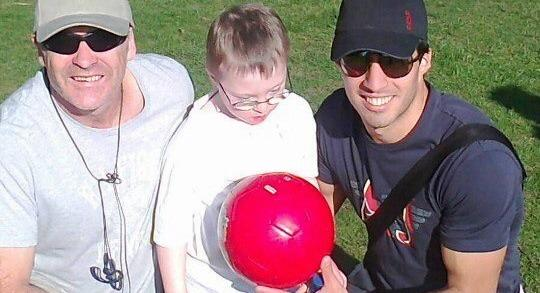 Luis Suarez at a Liverpool park with a 7-year old kid.