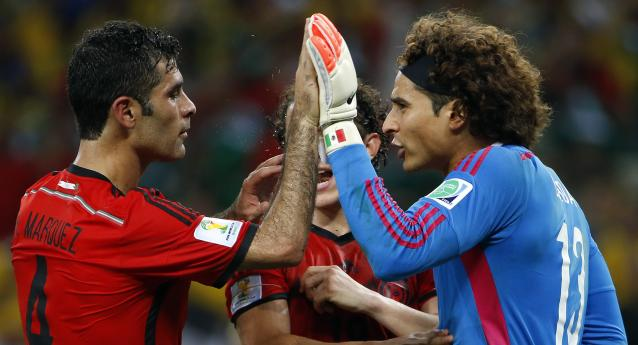 Jun 17, 2014; Fortaleza, Ceara, BRAZIL; Mexico goalkeeper Guillermo Ochoa (13) is congratulated by Mexico defender Rafael Marquez (4) after making a save on the goal line against Brazil during the second half of their 0-0 tie in a 2014 World Cup game at Estadio Castelao. Mandatory Credit: Winslow Townson-USA TODAY Sports