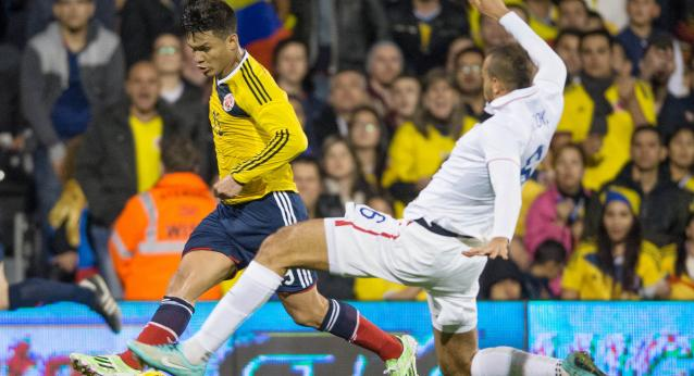 Nov 14, 2014; London, Great Britain; Colombia player Teofilo Gutierrez battles for the ball with USA player John Brooks during the first half of the game between USA and Colombia at Craven Cottage Mandatory Credit: Steve Flynn-USA TODAY Sports